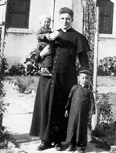 Columban Fr. William Holland and two children