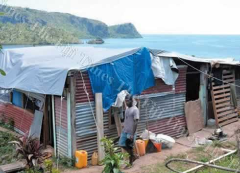 Ten months after the cyclone families are still living in tents and scraps put together to build dwellings.