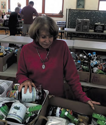 Mary Joesten at work at the food pantry