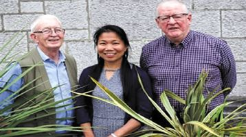 Angie with Fr. Berne Steed (left) and Fr. Oli McCrossan (right)