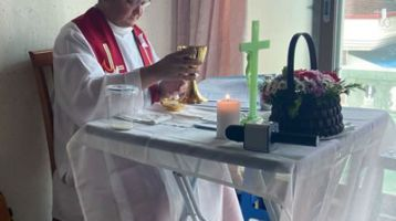 Fr. Borque celebrates Mass in a home.