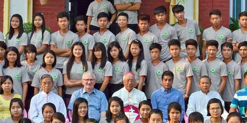 Fr. Neil Magill and Bishop Paul Grawng with HEC students in Myanmar.